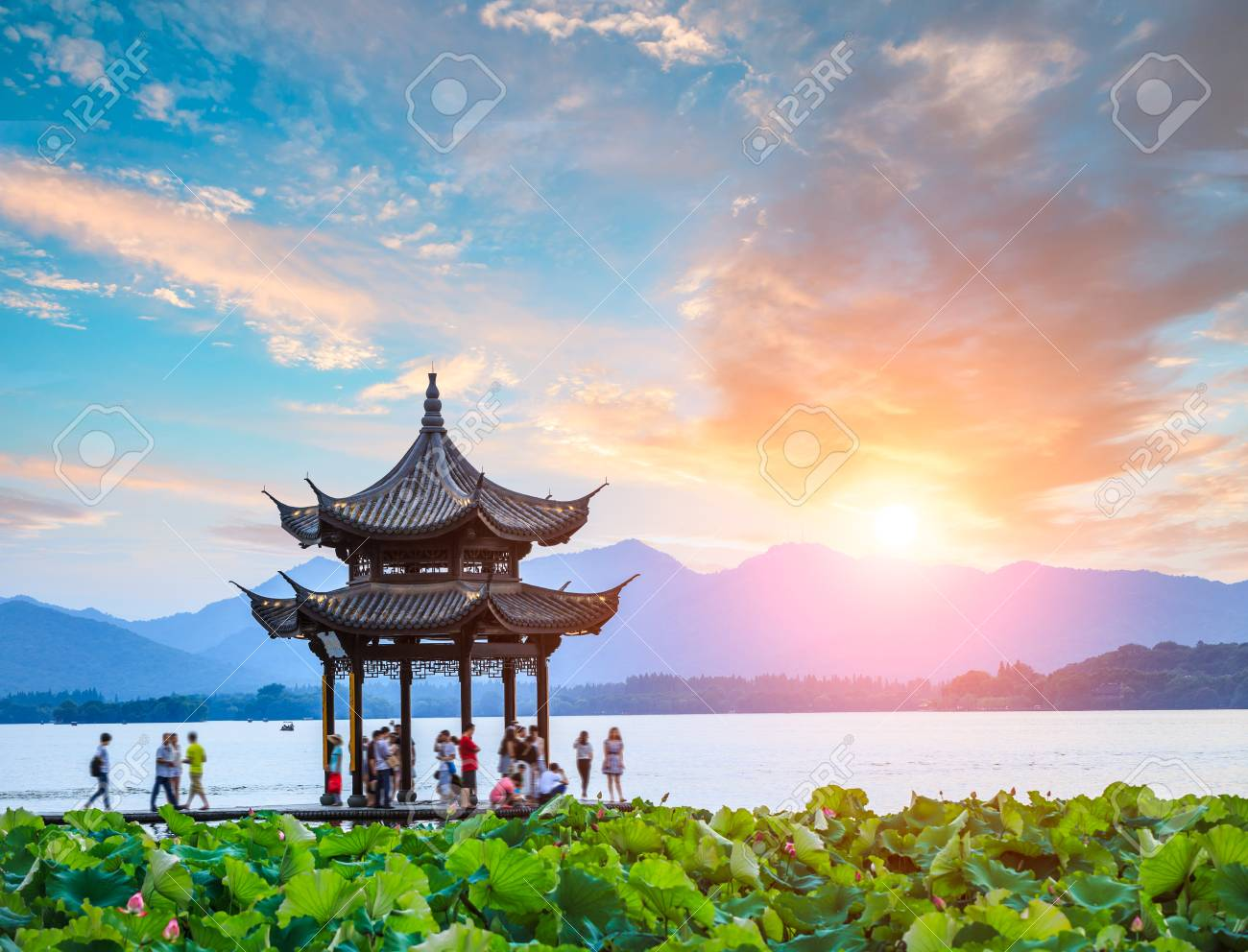 ancient pavilion of Hangzhou west lake at dusk, in China - 78563914
