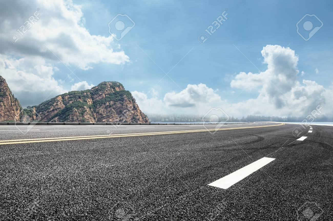 asphalt road and mountain background - 81042219