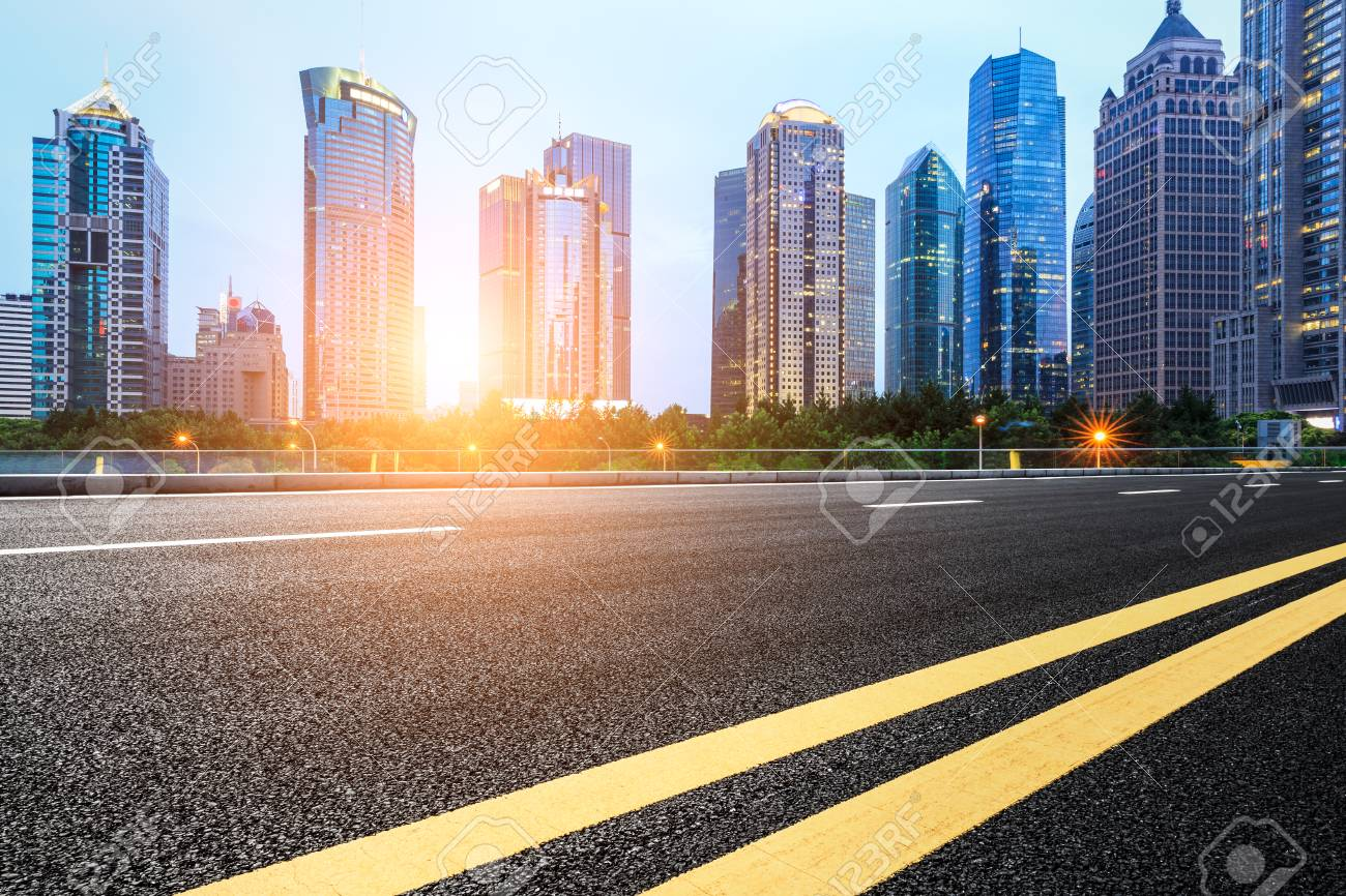 asphalt road and modern buildings in shanghai china stock photo