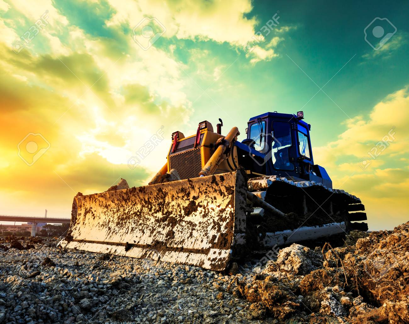 bulldozer on a building site at sunset - 89256049