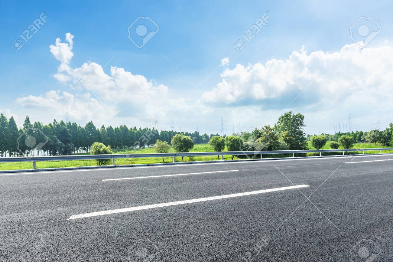 country asphalt road and green trees nature landscape in the summer - 92656908