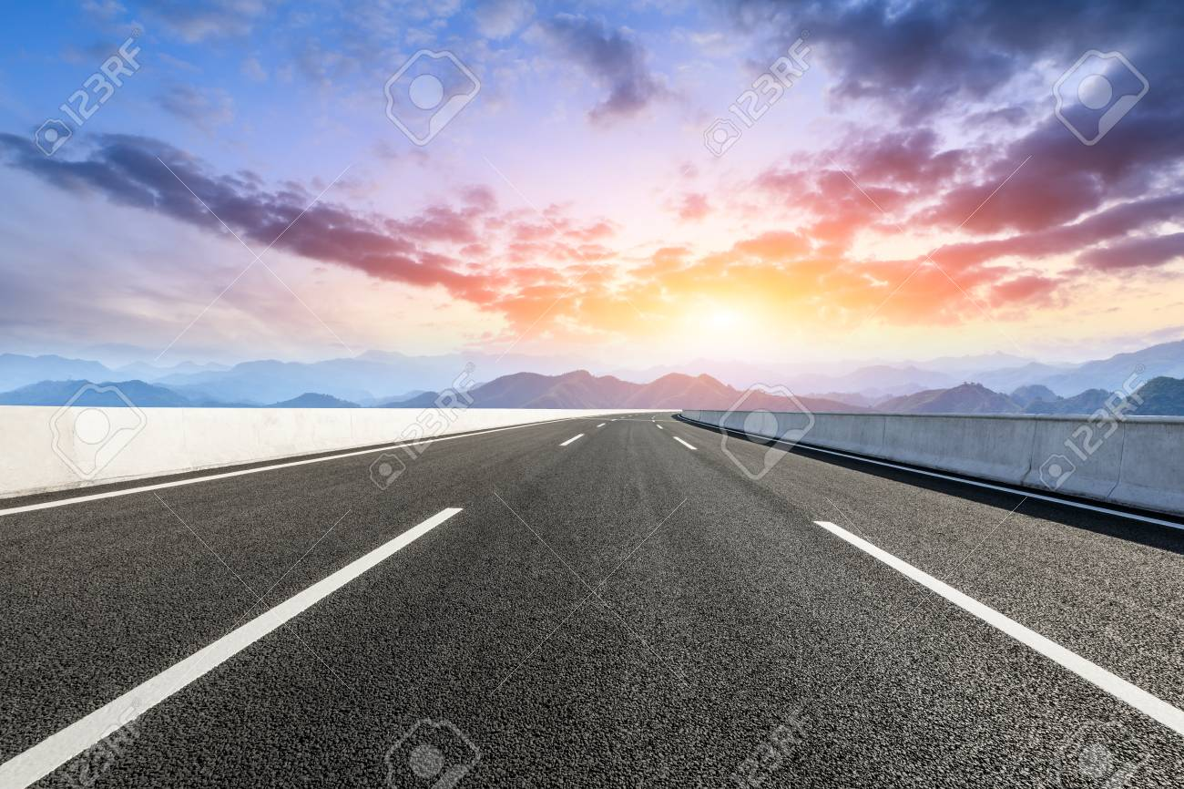 Asphalt road and mountains at sunset - 111757735