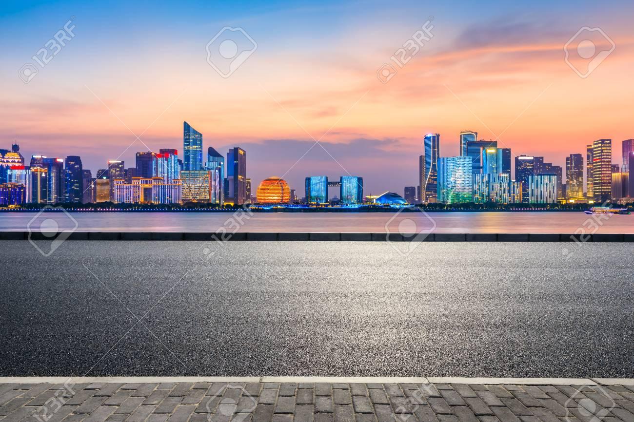 Empty asphalt road through Hangzhou business district - 117270558