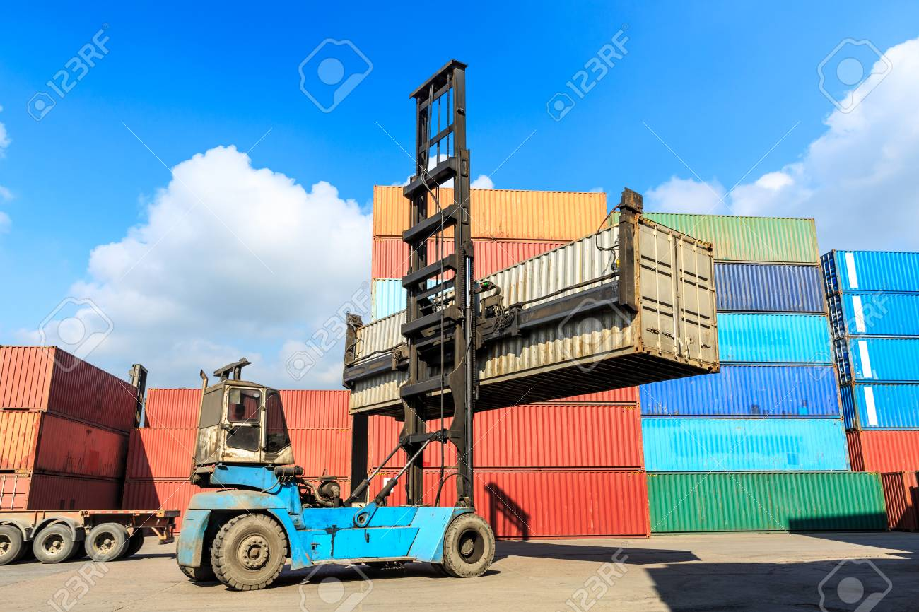 Forklift container loading and unloading cargo into the import-export