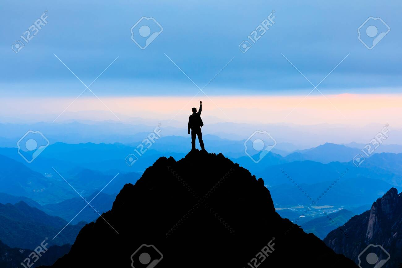 Happy man posing gesture of triumph with hands in the air,conceptual scene - 123719763
