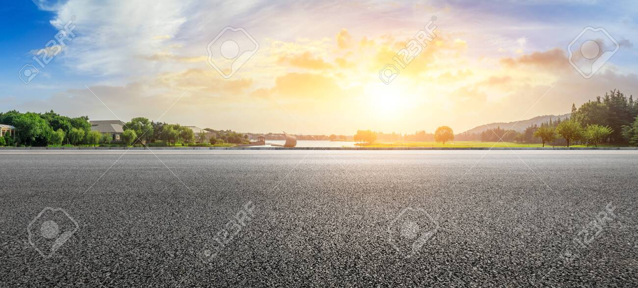 Empty asphalt road and beautiful natural scenery in city park - 128748284