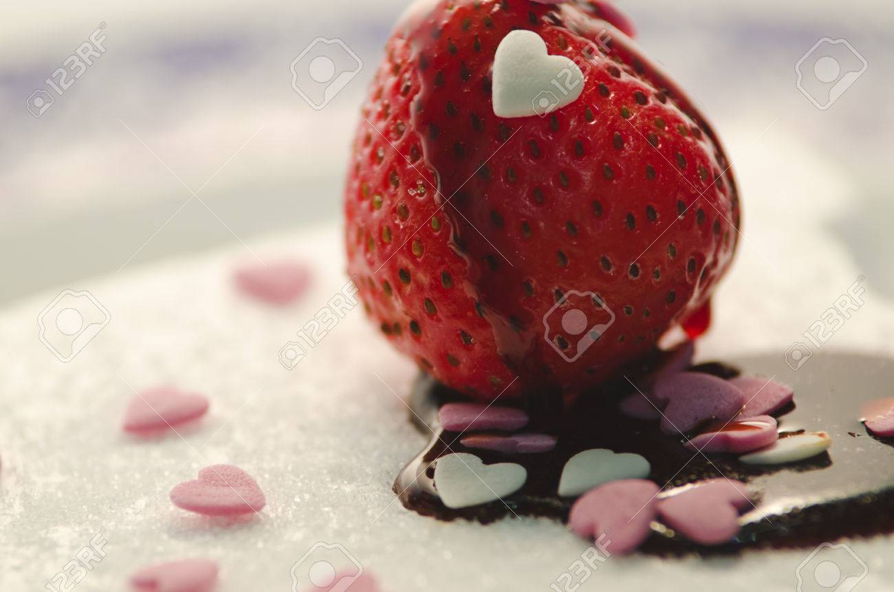 Chocolate Covered Strawberry And Hearts On Birthday Cake Stock Photo