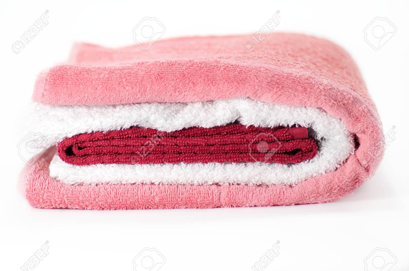 White, red and pink Terry towels isolated on white background Stock Photo - 12956478