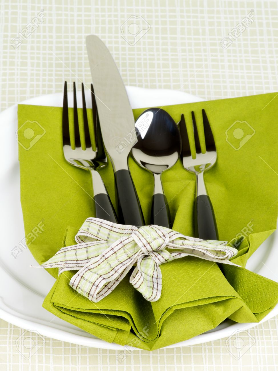 Elegant Table Setting with Fork Table Knife Spoon and Dessert Fork into Green Napkin & Elegant Table Setting With Fork Table Knife Spoon And Dessert ...