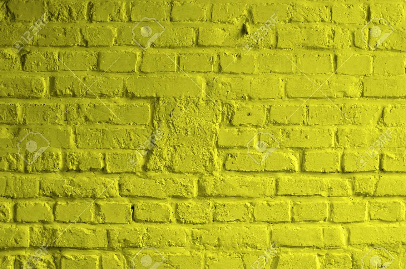 Background Of Brick Wall Painted With Mortar Yellow Lemon Color ...