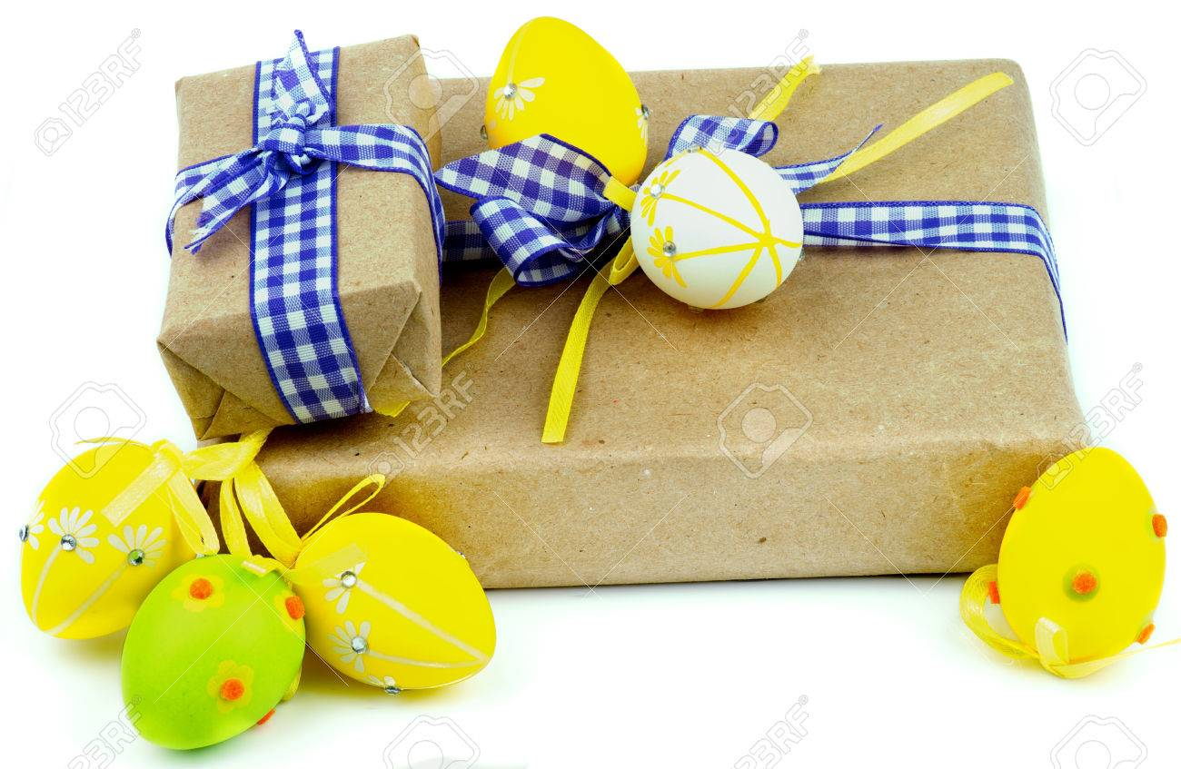 Two easter gift boxes decorated with checkered ribbons and yellow stock photo two easter gift boxes decorated with checkered ribbons and yellow and green easter eggs isolated on white background negle Gallery