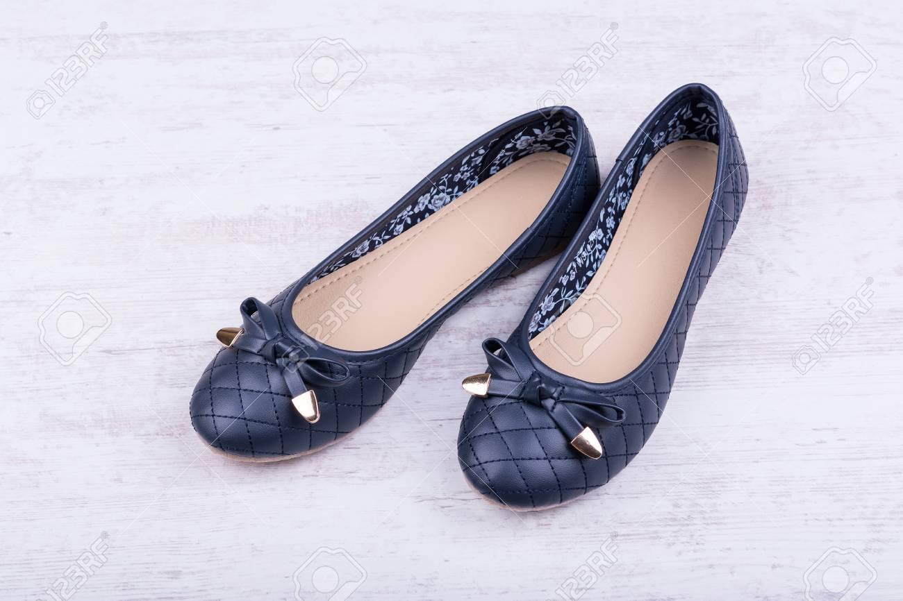 Pair Of Dark Blue Ladies' Flat Shoes On