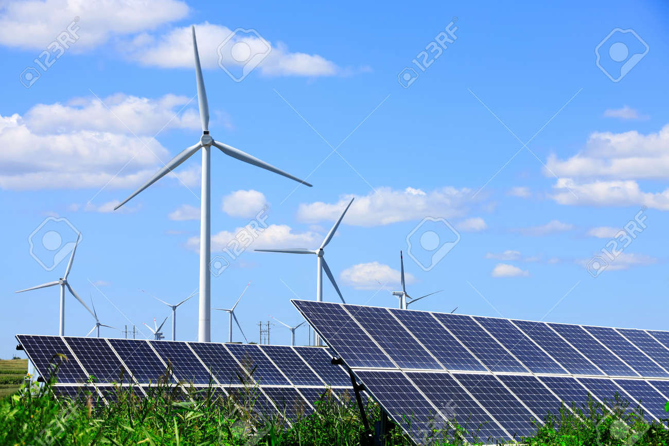 Solar photovoltaic panels and wind turbines. Energy concept - 169142225