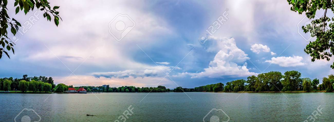 background panorama, dramatic clouds over the city lake, Ivano-Frankivsk,