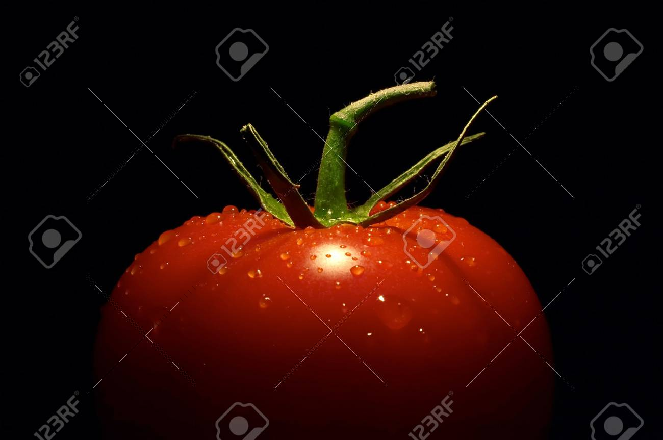 half the tomato on black background Stock Photo - 2634782