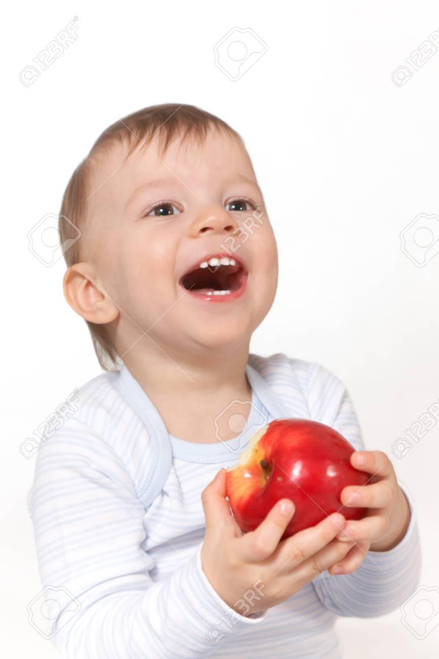 laughing baby with red apple Stock Photo - 4207245
