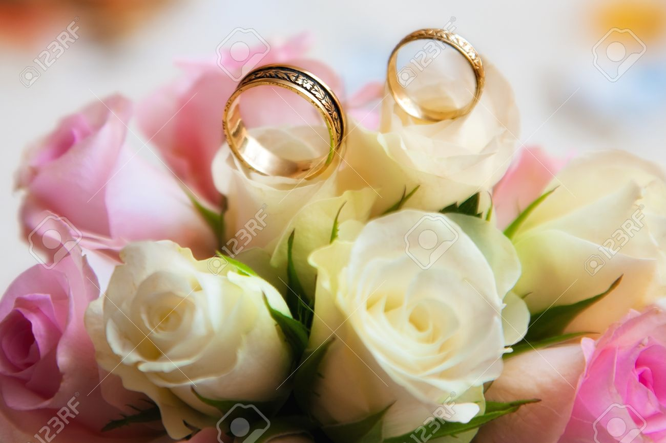 a online at inside image in of close bouquet celebration or rings white wedding flowers pair up bands stock