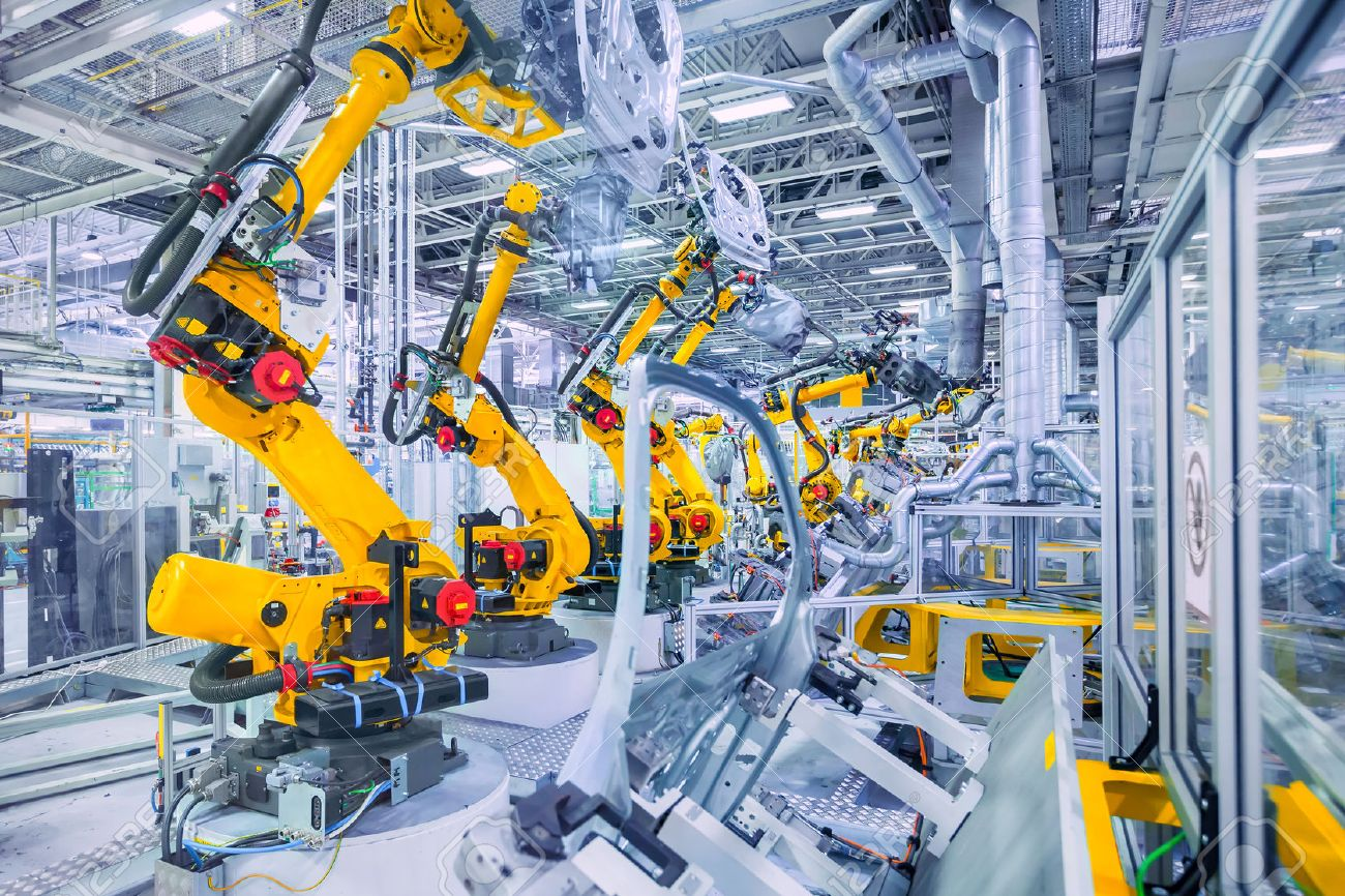 robotic arms in a car plant - 52036540