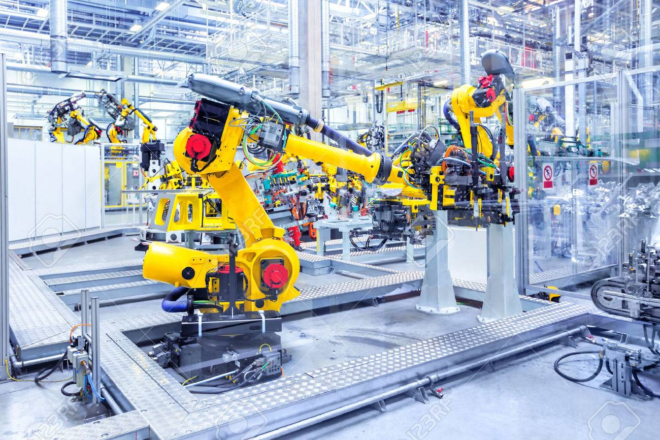 robotic arms in a car plant - 53747788