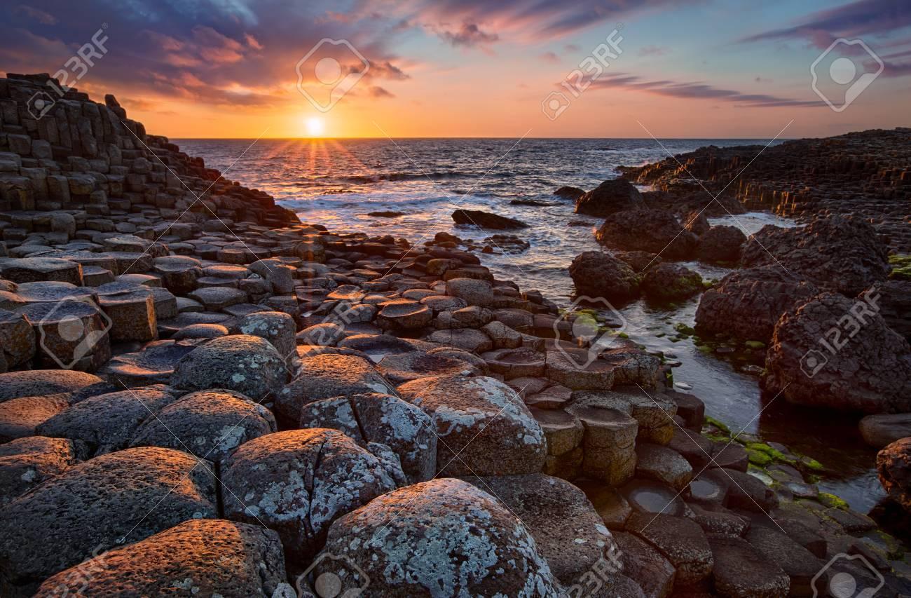 sunset over basalt columns Giants Causeway known as UNESCO World Heritage Site, County Antrim, Northern Ireland - 82065136