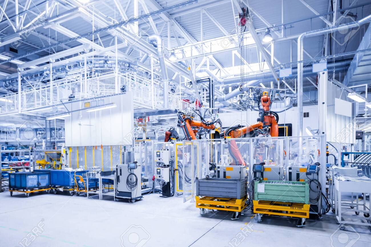 robotic arms in a car plant - 137875959