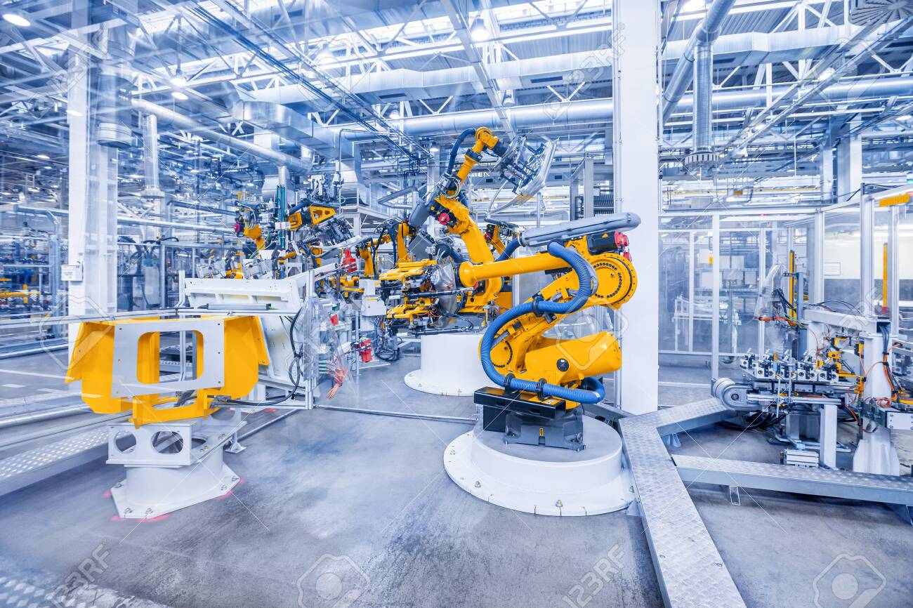 robotic arms in a car plant - 137895712