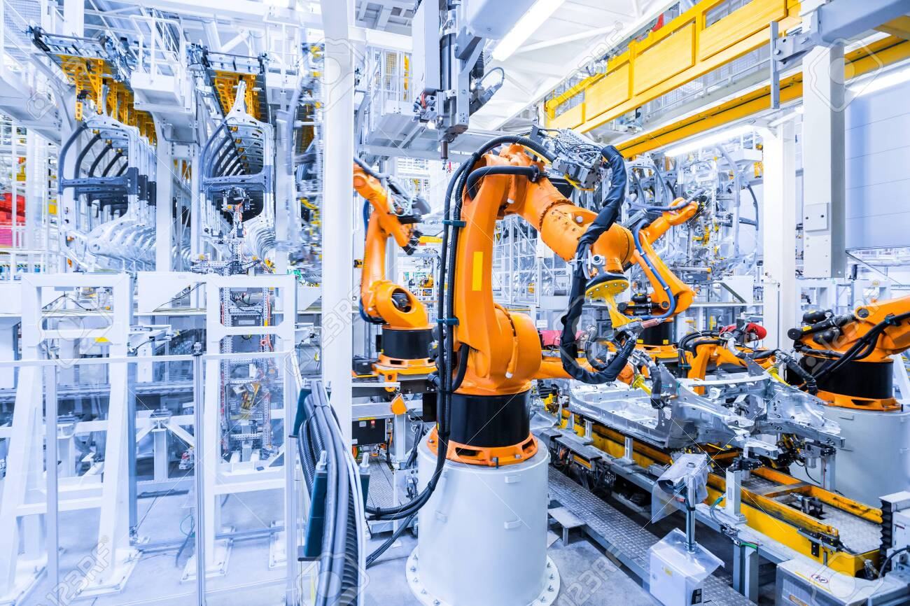 robotic arms in a car plant - 147881262