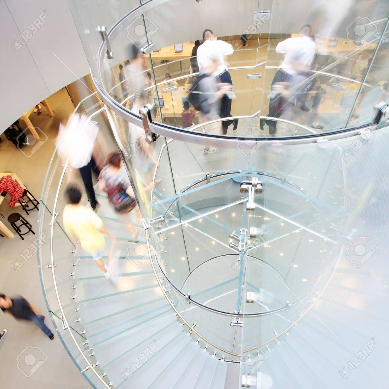 modern glass spiral staircase in shop with motion step Stock Photo - 12591100