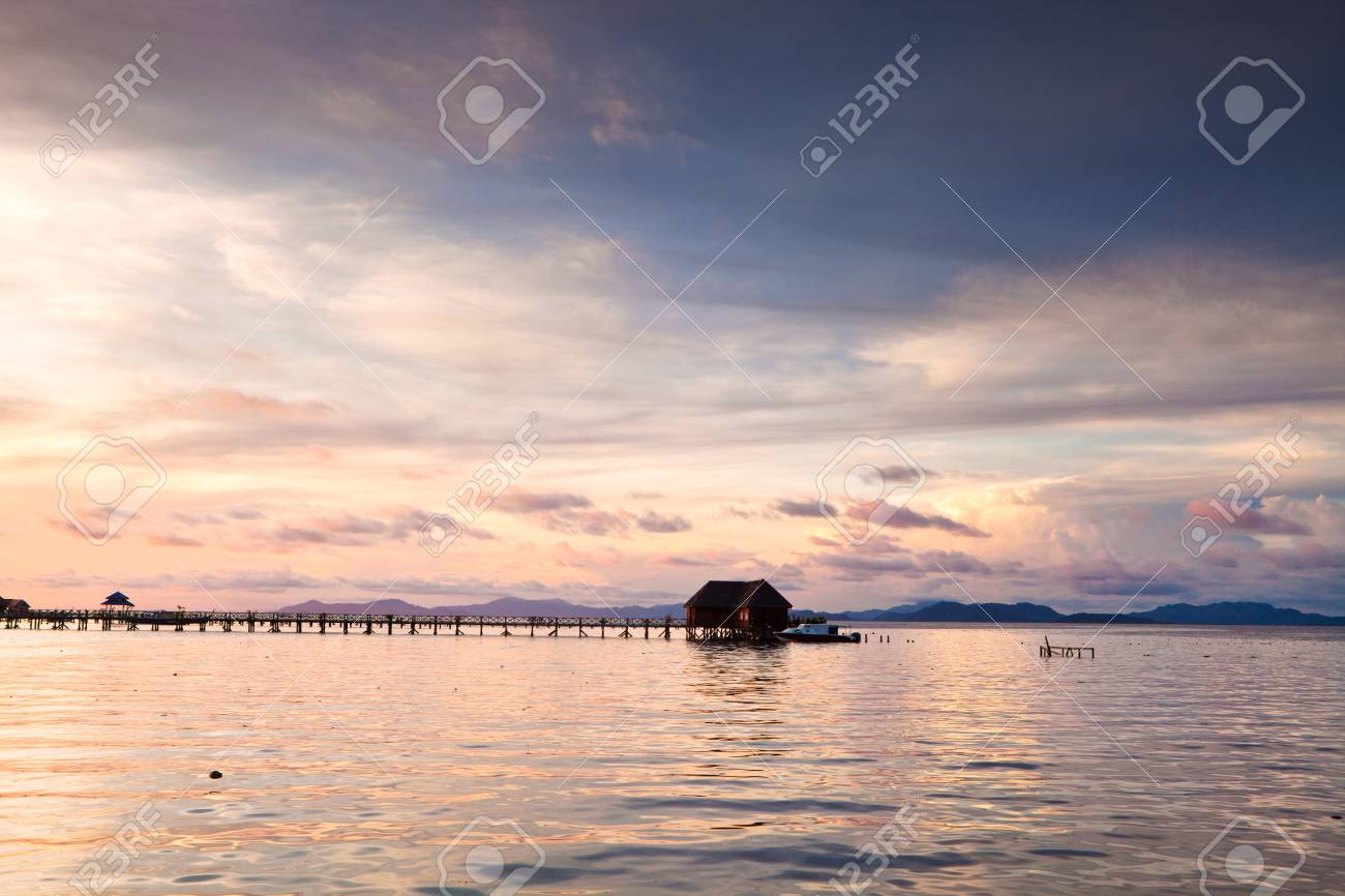 house over water at coastline with sunset Stock Photo - 14331474