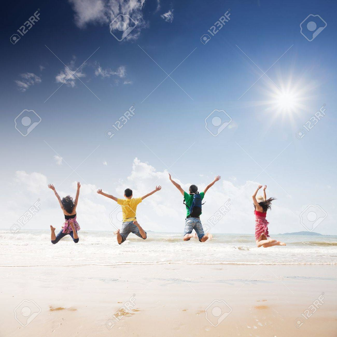 friends jumping on beach Stock Photo - 16302795