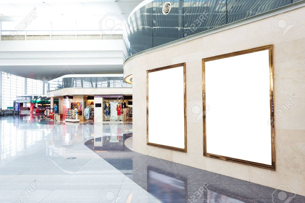 Blank Poster Board Wall In Modern Shopping Mall Stock Photo