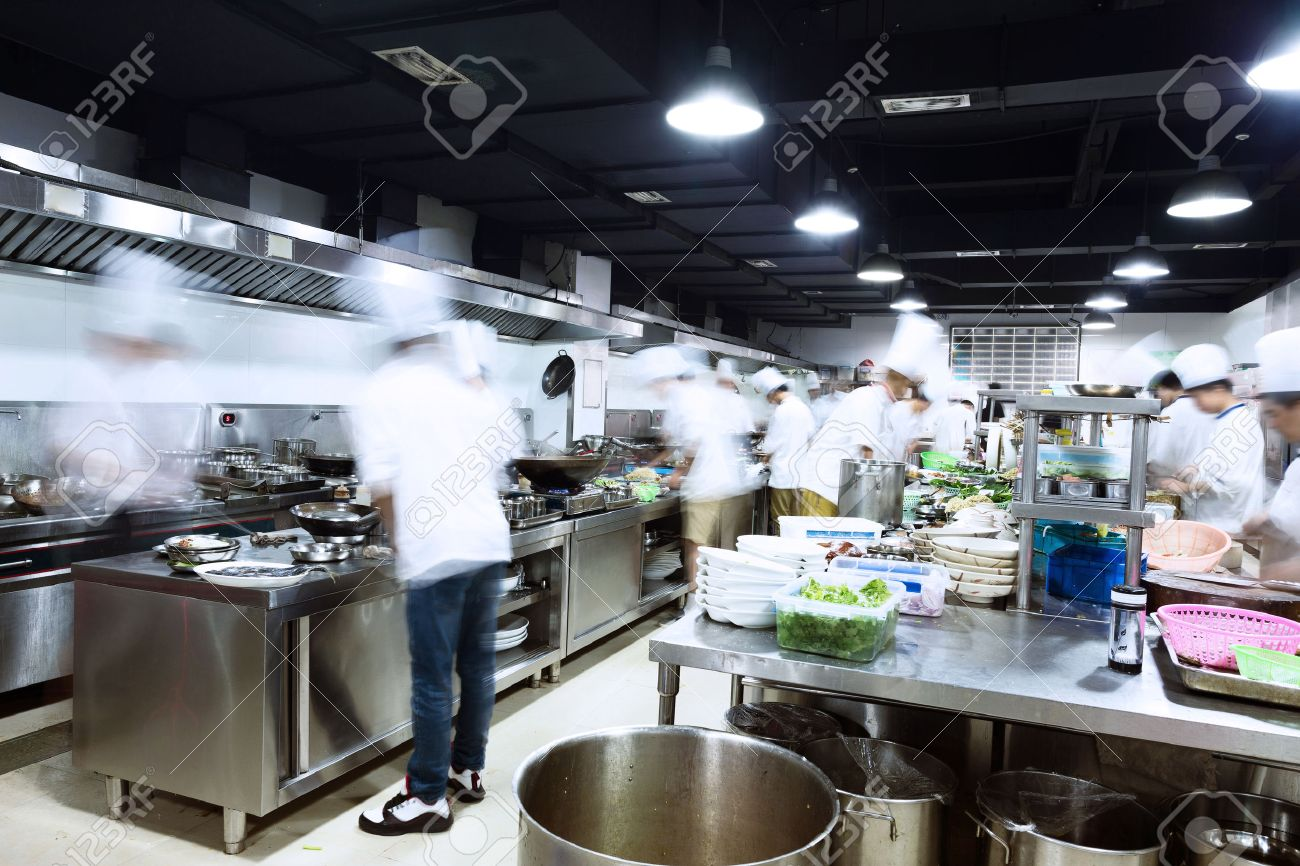 Restaurant Kitchen Chefs modern kitchen and busy chefs stock photo, picture and royalty