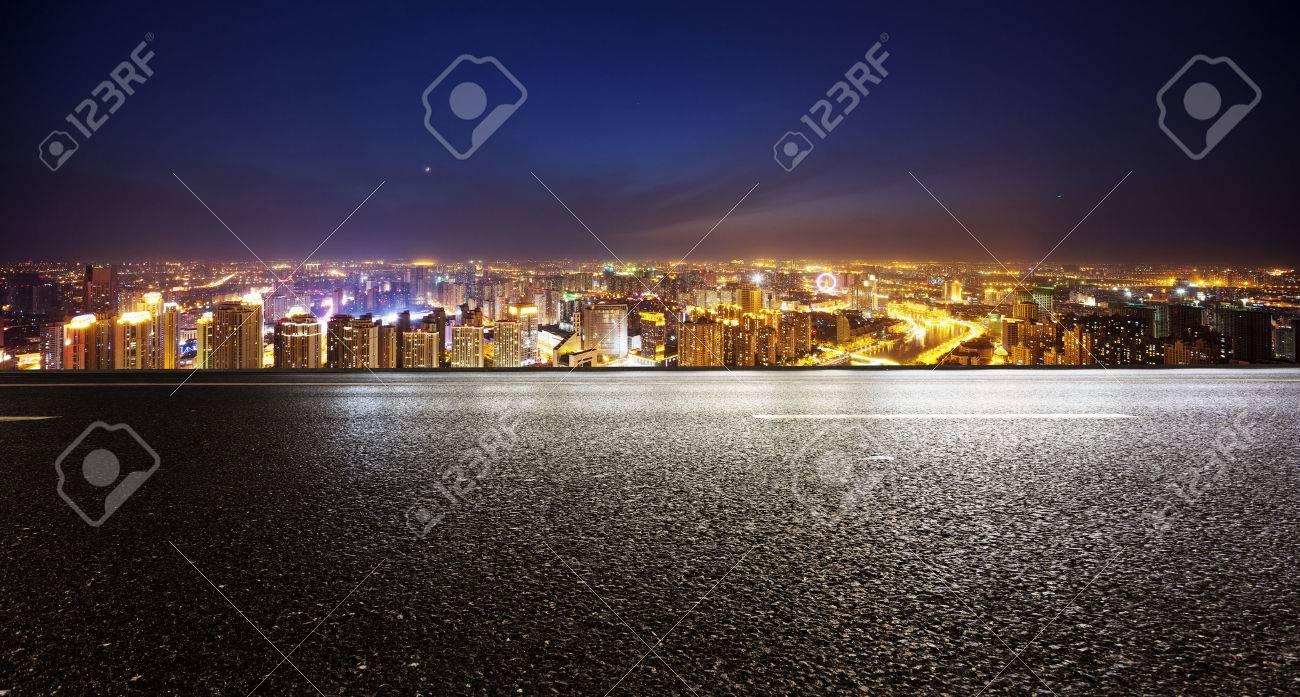 Empty asphalt road and modern skyline at night - 41369822