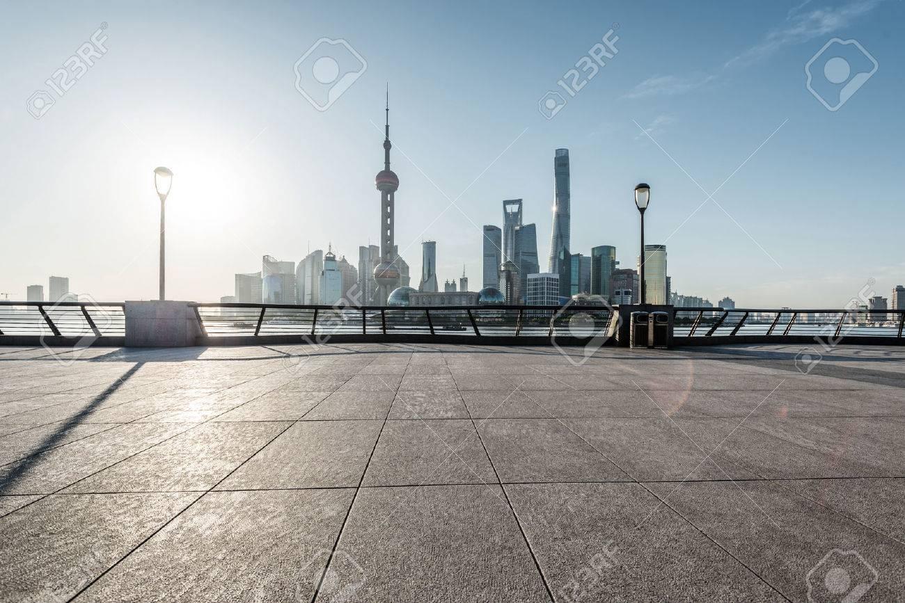 panoramic skyline of shanghai with empty street floor - 84379321