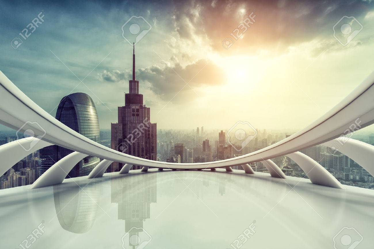 Modern city skyline with empty indoor floor at sunset - 44827532