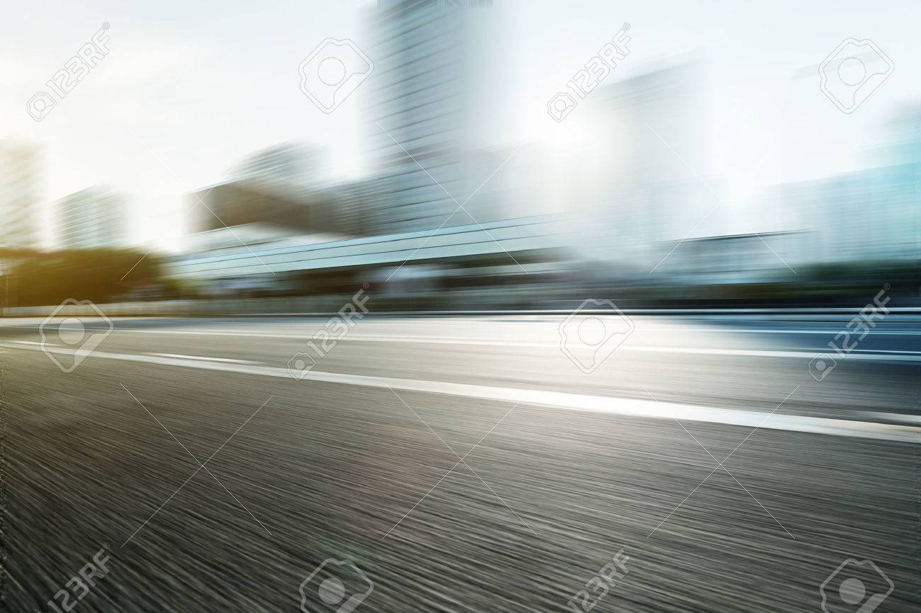 Blurred motion of modern skyline and urban street - 42487964