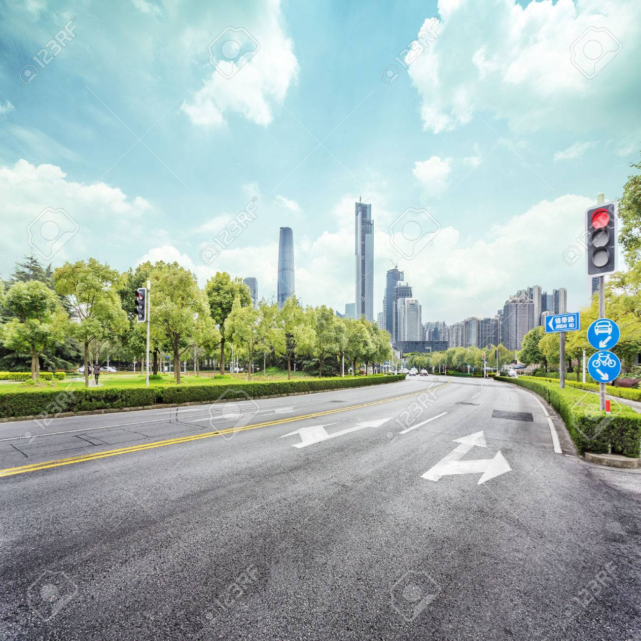 empty street with trees aside and skyscrapers as background - 45548657