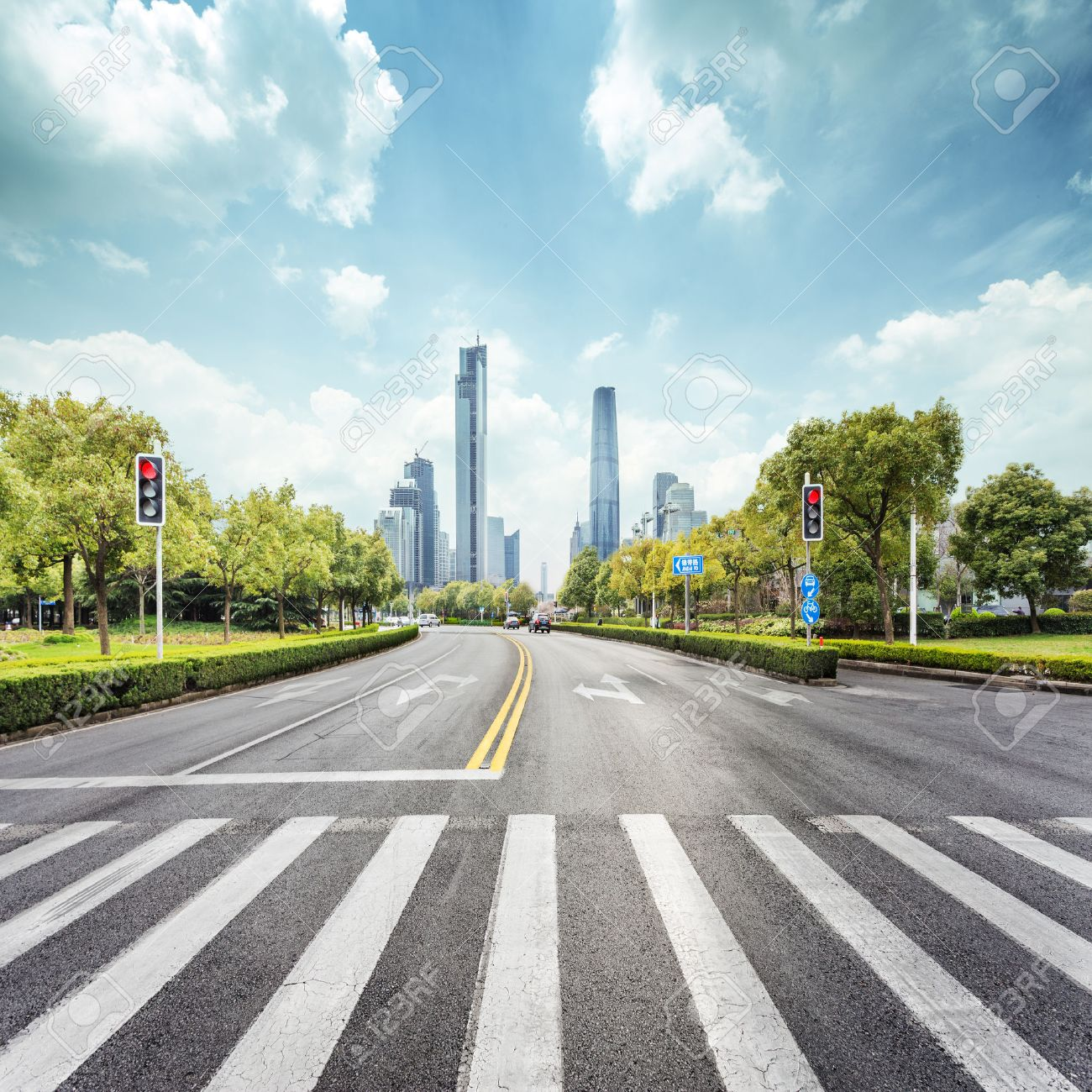 empty road with zebra crossing and skyscrapers in modern city - 45548663