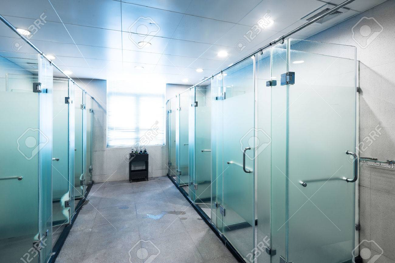 shower with glass in bathroom of gym - 65921037