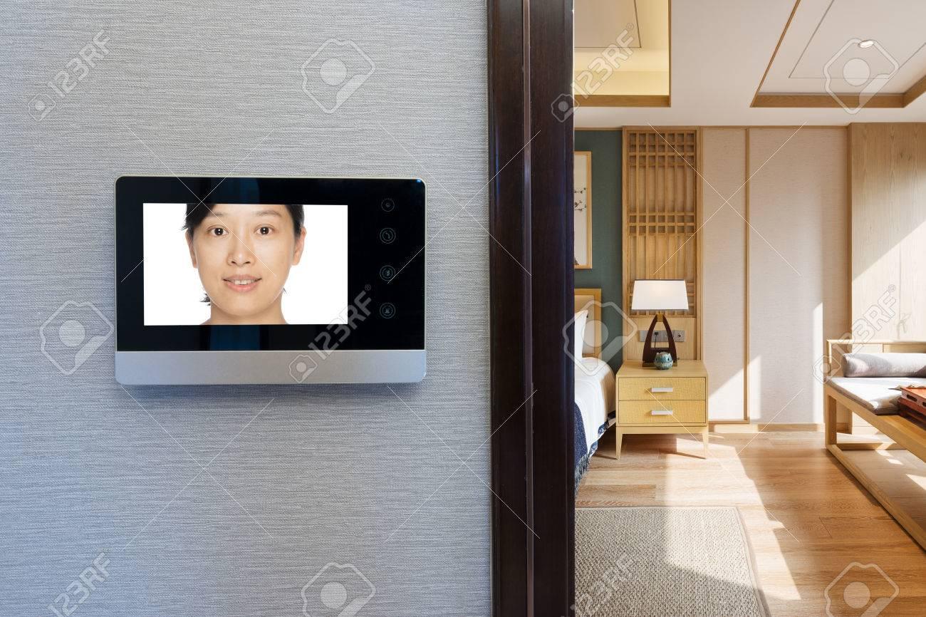 intercom video door bell on the wall outside modern dining room - 67731146