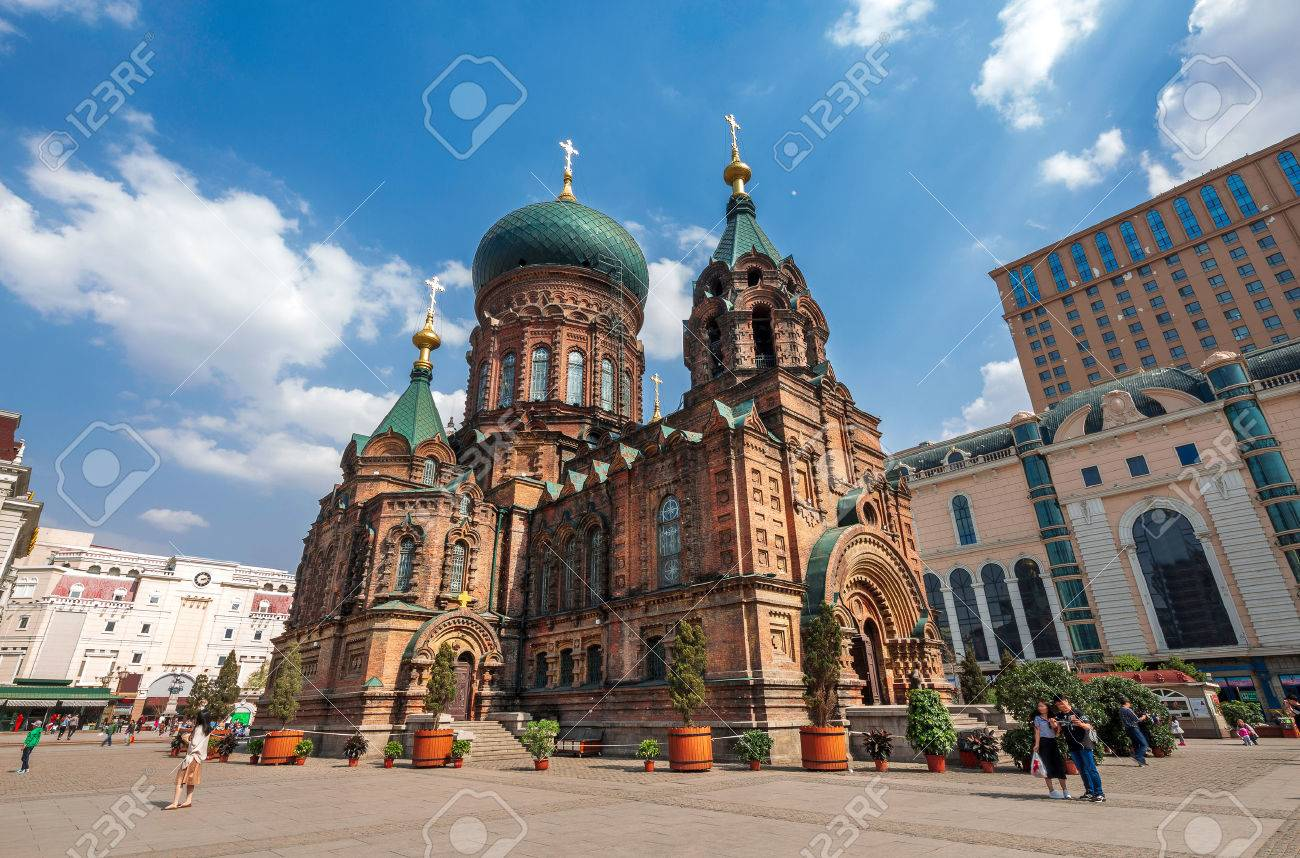 famous harbin sophia cathedral in blue sky from square - 69749303