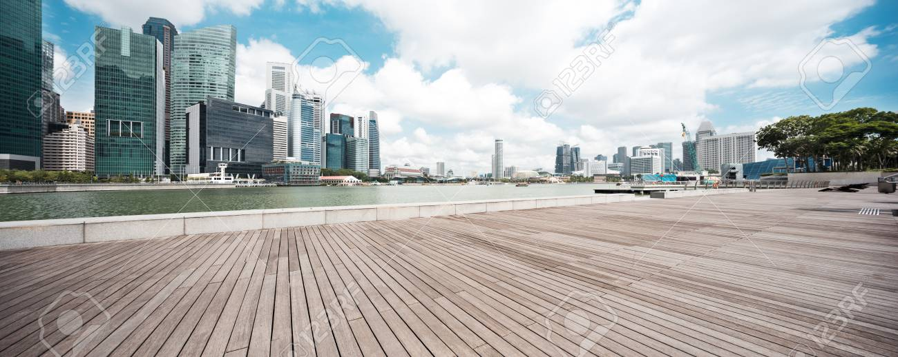 empty wooden floor with modern buildings in singapore - 81054996