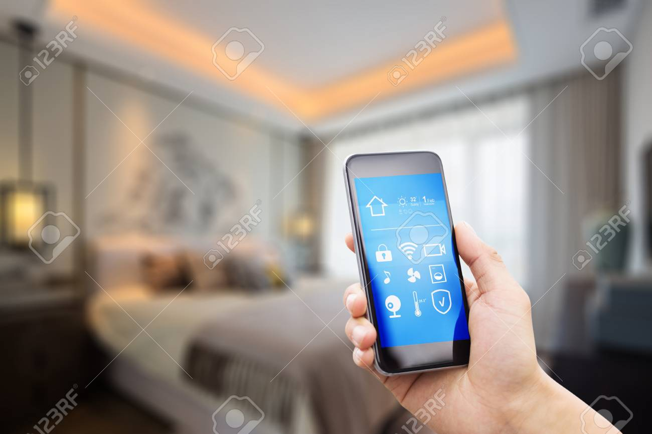 mobile phone with apps on smart home in modern bedroom - 81851471