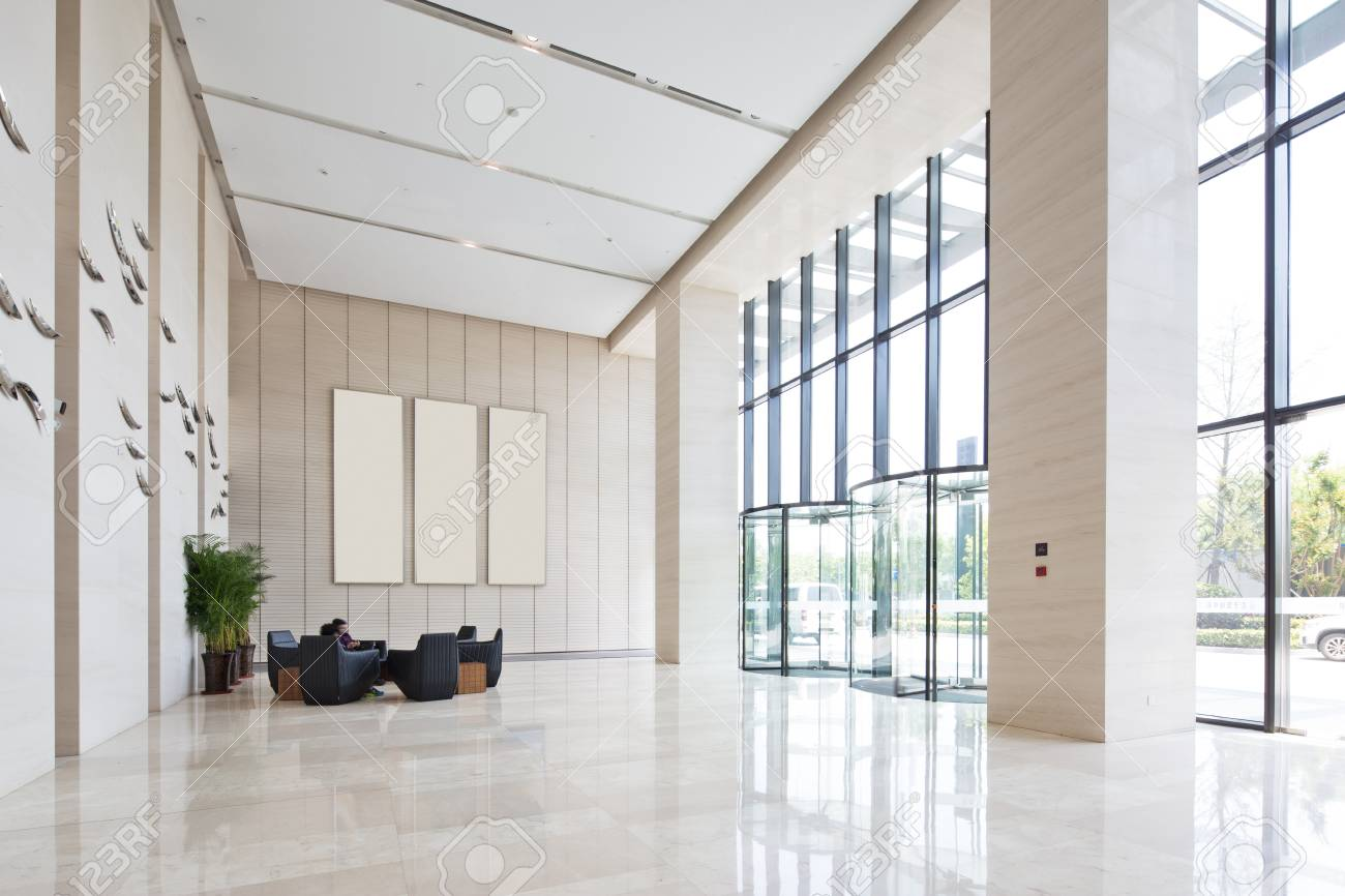 interior of spacious and bright entry hall in modern office building - 83150445
