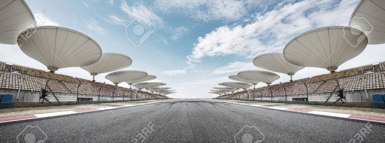 empty asphalt car racing track front of stands with abstract lights - 84882997