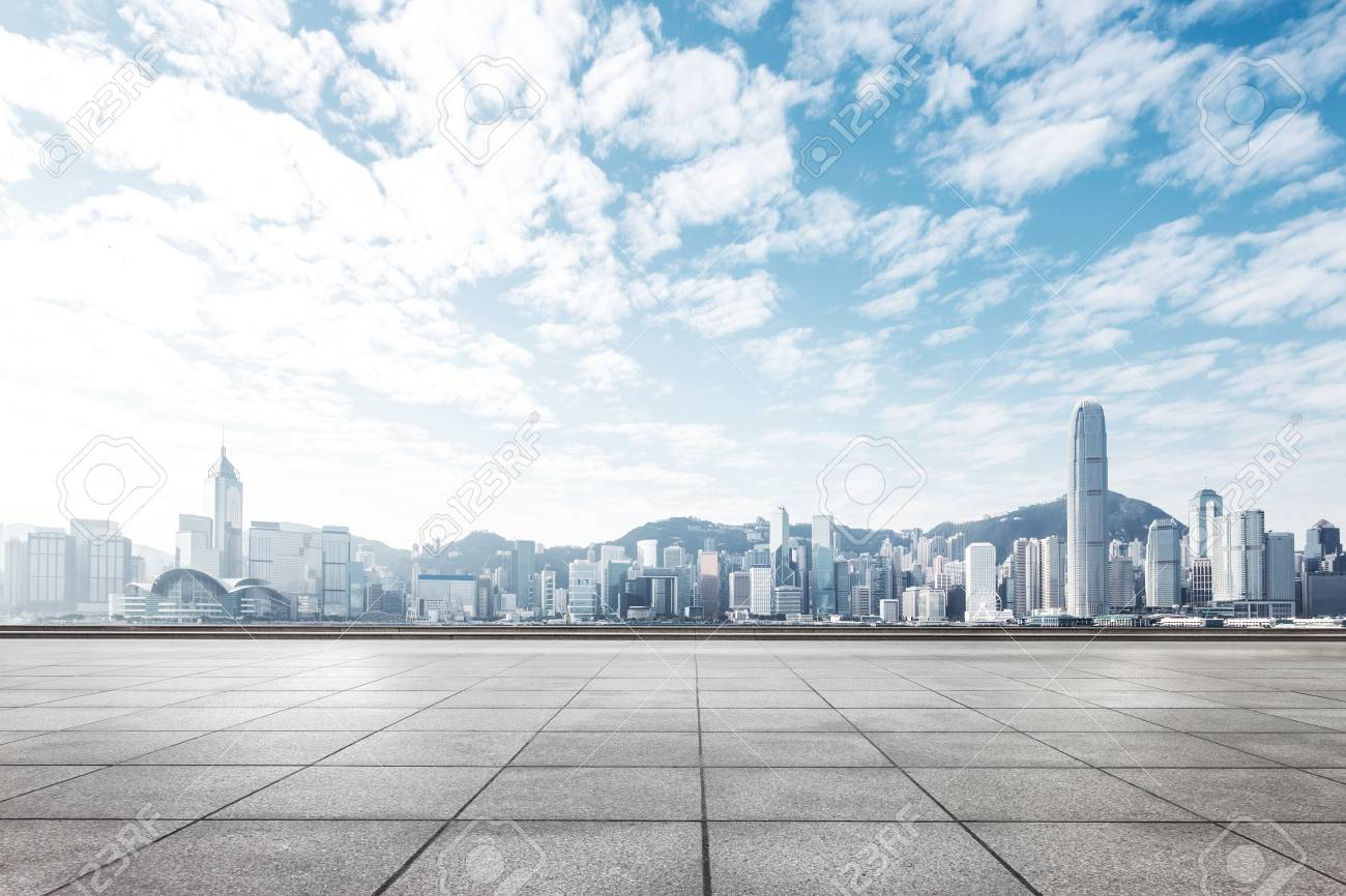 empty concrete floor and cityscape of hong kong in blue cloud sky - 92030039