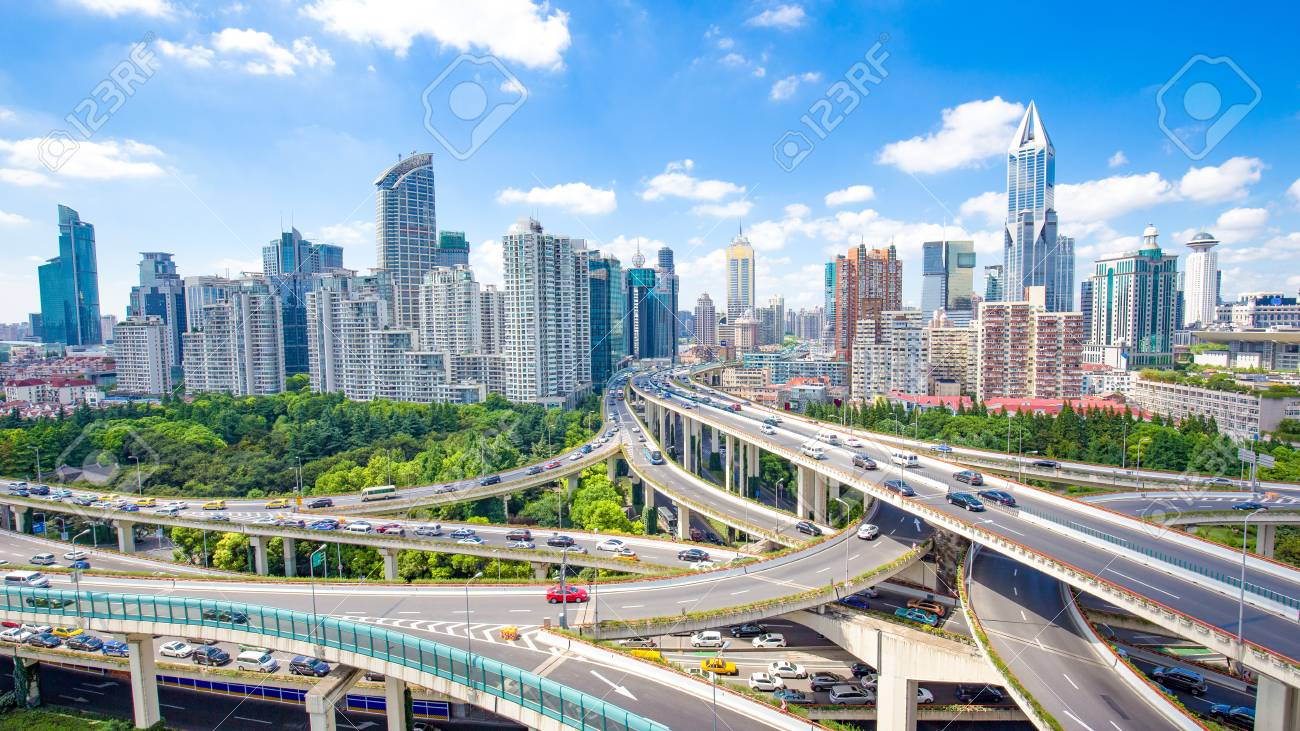 road junction and modern buildings in shanghai in blue cloud sky from high angle view - 93069646