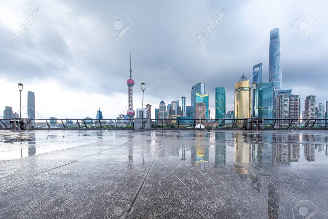 modern buildings near river in shanghai lujiazui CBD in cloud