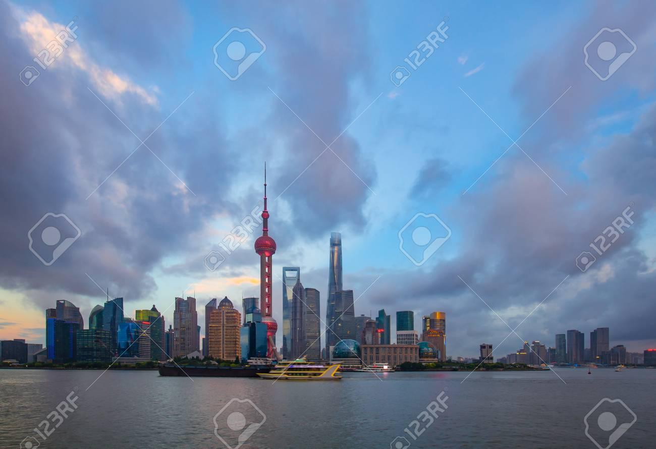 modern buildings near river in shanghai lvjiazui CBD in cloud
