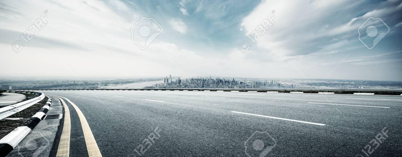 empty highway through modern city - 109005250